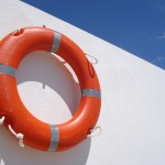 white wall, red buoy and blue menorca sky